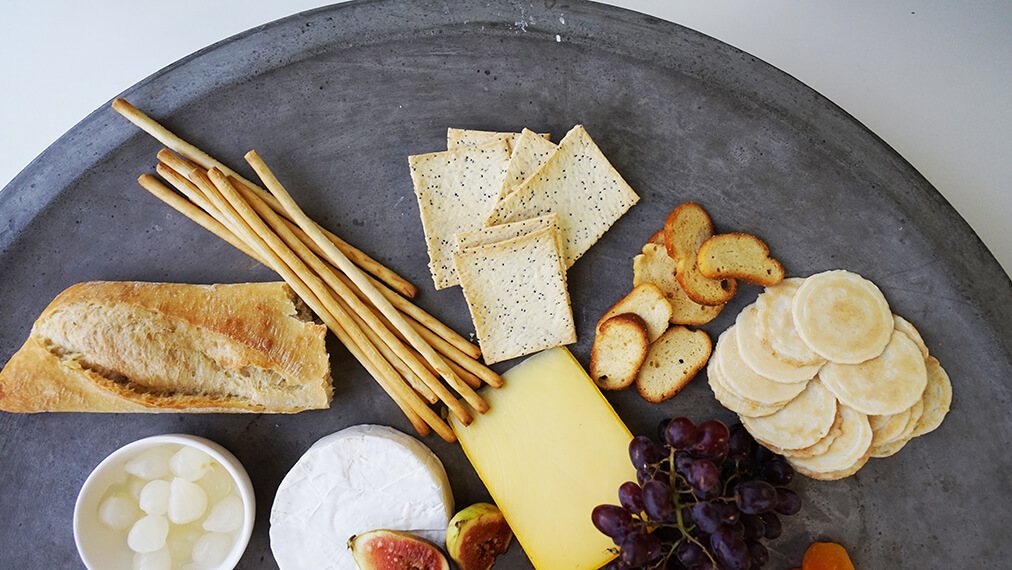 Choose baguettes, plain crackers, breadsticks to complement Président's cheese types